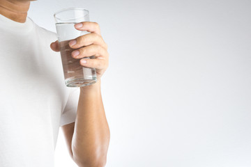 Hand holding a glass of water