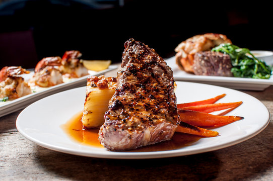 New York Strip with Potato Bake and Grilled Organic Carrots