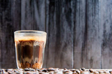 espresso in a glass on wooden table