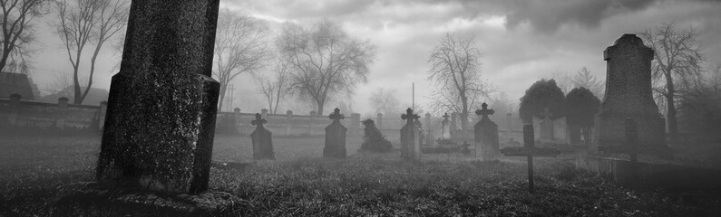 Old creepy graveyard on stormy winter day in black and white Fototapete