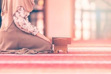 Young muslim woman reading koran in mosque Wall mural
