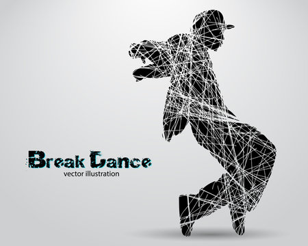 Silhouette of a break dancer.