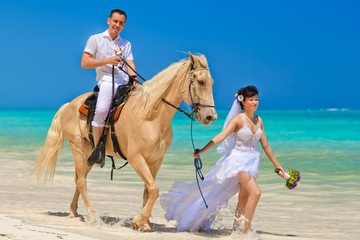 groom leads the horse when the bridegroom is sitting on the horse