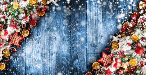 Merry Christmas Frame with Snow and real wood green pine, colorful baubles