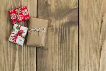 gifts boxes  on wooden table background top view