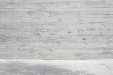 Gray concrete rough wall with wooden veining and empty floor background