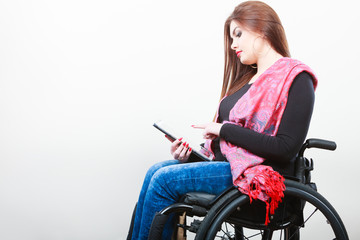 Young disabled lady with tablet.