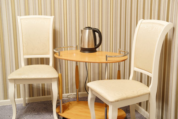 Table and chairs in a hotel room