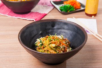 Traditional Japanese Chuka Wakame seaweed salad with sliced carrot, cucumber and Nut Sauce. Garnished with Sesame Seeds