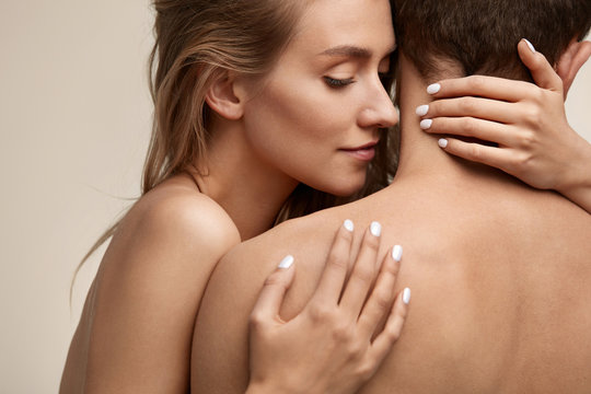 Beautiful Young Woman Smelling Man Smooth Skin. Couple In Love