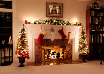 Living room decked out for the Christmas holidays with trees, stockings and a warm, welcoming fire
