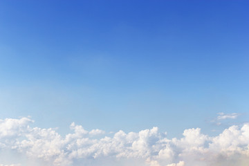 White clouds and blue sky background.
