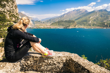 Sporty woman admire the panorama from the Ponale trail in Riva d Wall mural