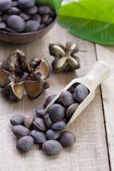 dried capsule seeds fruit of Sacha Inchi peanut on wooden