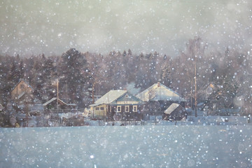 rural landscape with small houses on a snowy day