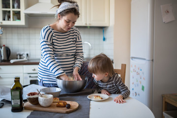 fun young pregnant mother   with son Toddler, make  dough for ba
