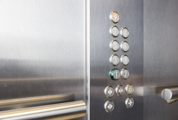 In the elevator floor buttons