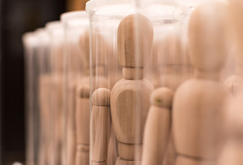 Army of wooden mannequins in boxes