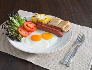 American breakfast with vegetables in white dish