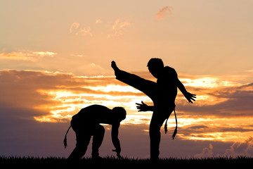 capoeira dance at sunset