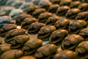 Rows of wooden Egyptian scarabs
