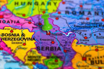 Belgrade in Serbia pinned on colorful political map of Europe. Geopolitical school atlas. Tilt shift effect.