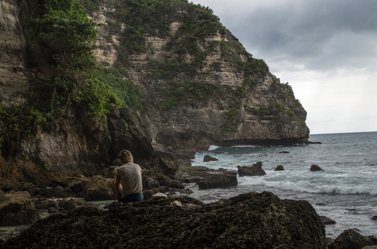 Woman chilling at the beach near Temeling, Nusa Penida