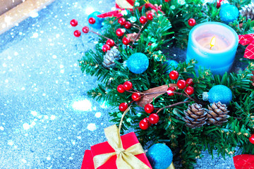 Beautiful Christmas wreath,blue candle,berries