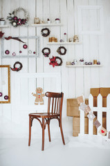 Christmas room with many details and wood chair