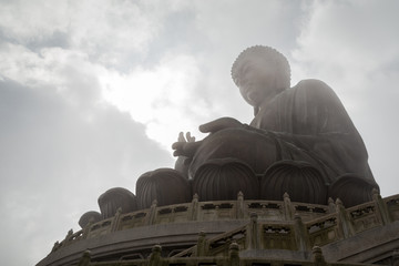 Silhouette of the Tian Tan Buddha (Big Buddha) statue on Lantau Island in Hong Kong, China.