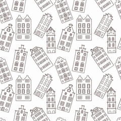 Seamless pattern with cute falling houses in black and white colors
