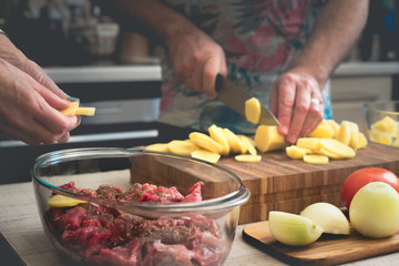 Cooking baked meat with potatoes  and vegetable horizontal