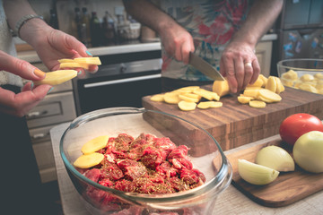 Cooking baked meat with potatoes  and vegetable
