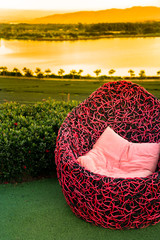 The concept of relax - Red sofa in the tea plantation