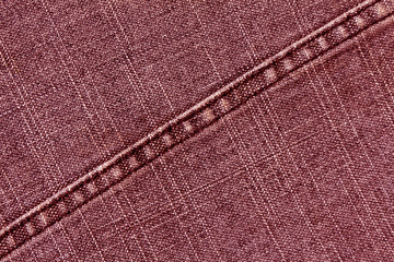 Red jeans cloth texture with stitch.