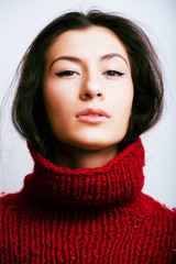 young pretty woman in sweater and scarf all over her face, lifes