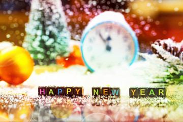 Text happy new year made with bricks at decorated background.