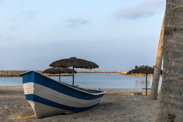 Boat on the beach in salalah oman sunrise time