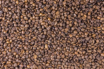 Coffee beans on wooden background are  the table top view concept