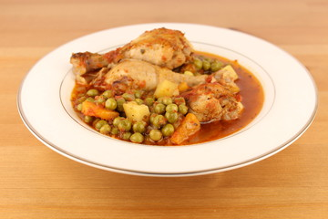 chicken and pea meal on white plate