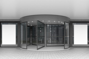 Glass doors of corporate building with posters