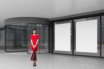 Woman in red near a mall
