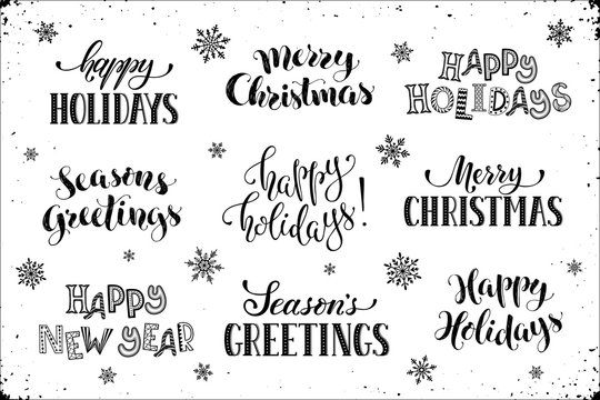 Hand written New Year phrases. Greeting card text  with snowflakes isolated on white background. Happy holidays lettering in modern calligraphy style. Merry Christmas and Season's Greetings lettering.