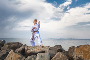 Young boy training karate
