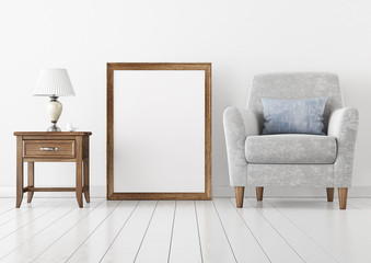 Vertical interior poster mock-up with empty wooden frame, armchair and lamp on white wall background. 3D rendering.