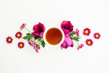Flowers and tea. Flat lay, Top view.