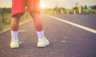 foot of a girl on the street asphalt