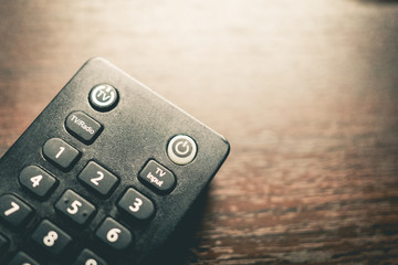Old TV remote with number pad and on off buttons.