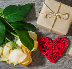 composition for Valentine's day, wedding, flowers, heart on wooden background