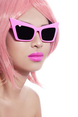 Young beautiful asian girl with stylish pink bob haircut in freaky vintage sunglasses over white background, copy space